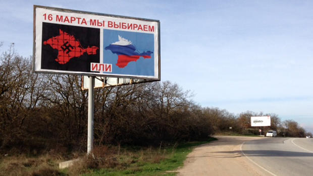 A billboard urging residents of Crimea to vote for their region to cede from Ukraine and become a part of Russia
