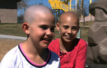 9-year-old punished by school after shaving head in support of friend