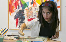 Afghan girl paints with help of prosthetic arm
