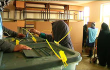Afghans defy Taliban threats, vote for new president