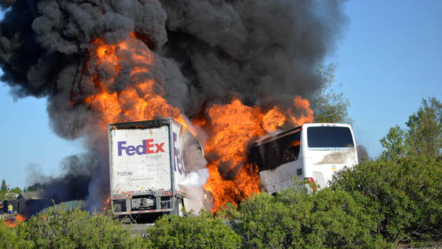 Massive flames are seen devouring a FedEx tractor-trailer and a bus just after they crashed near Orland, Calif., as clouds of smoke billow into the sky April 10, 2014.