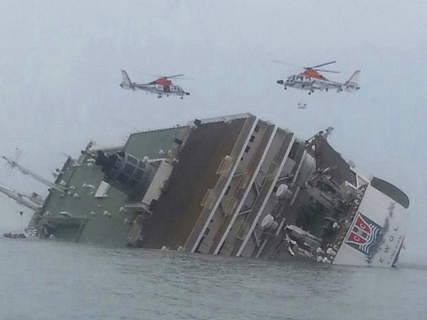 Helicopters hover over a South Korean passenger ferry as it sinks off the nation's southwest coast