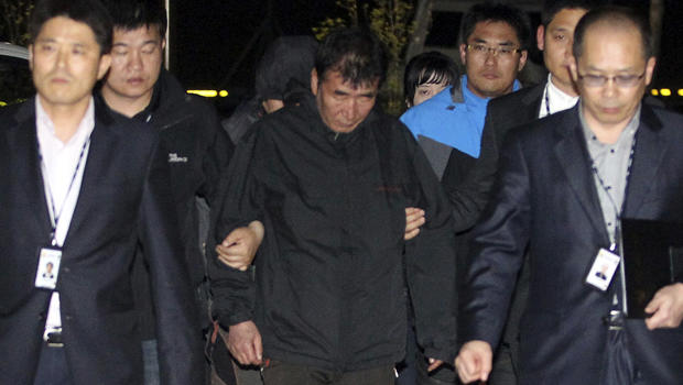 Lee Joon-seok, center, captain of the South Korean ferry Sewol, which capsized, arrives at a court in Mokpo, South Korea, April 18, 2014.