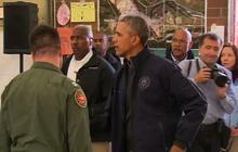 A month after deadly landslide, Obama tours disaster site