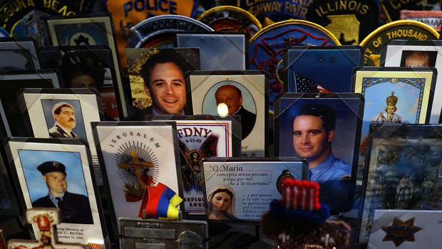 Cards, patches and mementos of those killed at ground zero are viewed during a preview of the National September 11 Memorial & Museum May 14, 2014, in New York City.