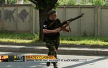 Ukraine troops fight insurgents at major airport