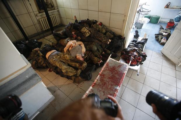 Bodies of separatists killed in a fight with pro-Ukrainian forces lay piled at a morgue in Donetsk