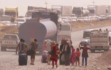 Iraqi civilians flee fighting, as militants close in