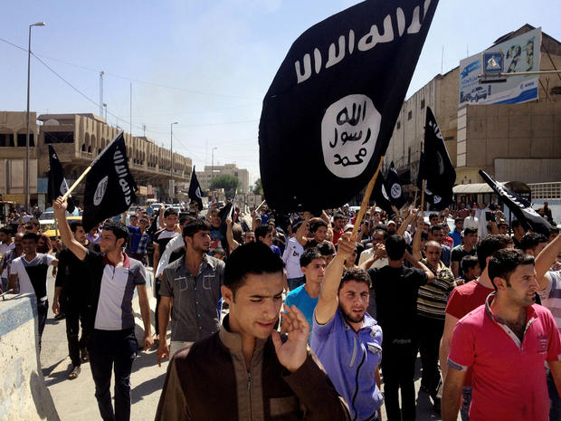 Demonstrators chant in support of al Qaeda-inspired Islamic State of Iraq and Syria as they carry al Qaeda flags in front of the provincial government headquarters in Mosul, Iraq, 225 miles northwest of Baghdad, June 16, 2014.