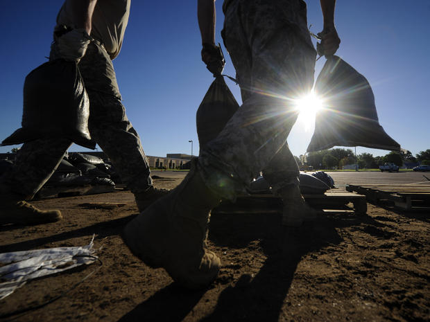 South Dakota National Guard troops fill sandbags in preparation for flooding along the Big Sioux River June 20, 2014, in North Sioux City, S.D.