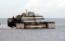 Time-lapse: Costa Concordia raised from underwater platform