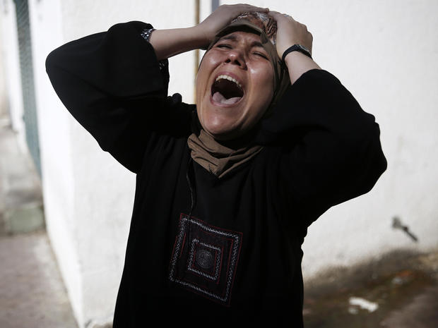 The mother of one of the four Palestinian children from the Baker family grieves outside the morgue in Gaza City July 16, 2014.