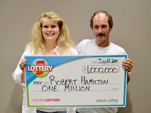 Robert Hamilton and wife Donna Hamilton of Indianapolis are seen after Robert won his second million-dollar lottery prize at Hoosier Lottery's headquarters in Indianapolis July 22, 2014.