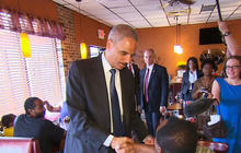 Attorney General Eric Holder promises justice after police shooting