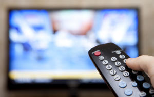 TV television remote pointing to screen