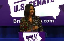 Michelle Obama fires up Iowa crowd, flubs candidate's name