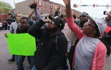 Baltimore erupts in cheers after officers charged