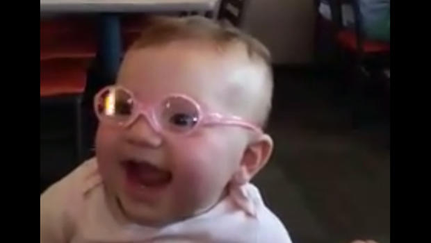 Viral video shows baby seeing clearly for the first time cbs news
