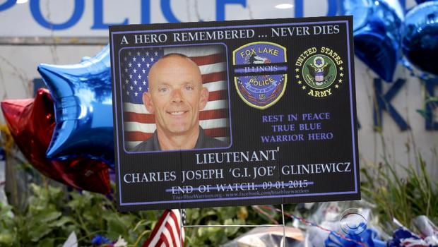 Sign outside Fox Lake, Illinois police headquarters pays tribute to Lt. Charles Joseph Gliniewicz, who was shot and killed September 1, 2015