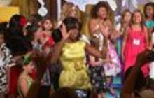 """Michelle Obama """"raises the roof"""" with winners of healthy recipe challenge"""
