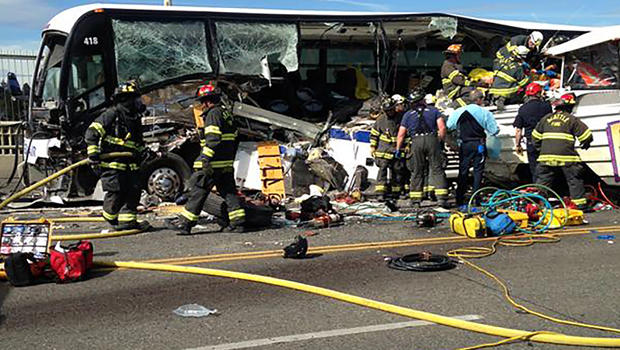 The Latest: Tour vehicle crash kills 2, critically hurts 9
