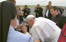 Pope blesses boy with cerebral palsy at airport