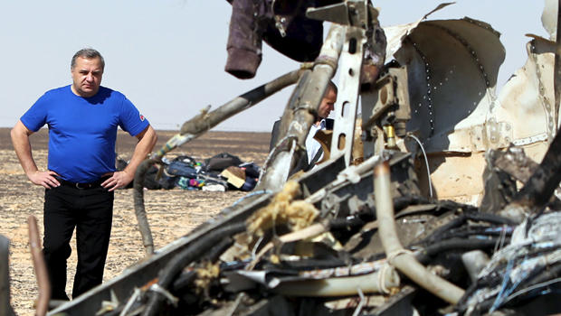 Russian Emergencies Minister Vladimir Puchkov looks at debris from a Russian airliner at its crash site in the Hassana area in el-Arish, Egypt, Nov. 1, 2015.