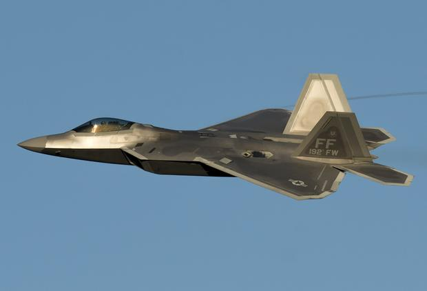 A US Air Force Lockheed Martin F-22 Raptor stealth fighter aircraft performs a demonstration