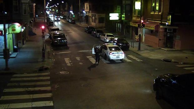 Officer Jesse Hartnett chases after a suspect identified by police as Edward Archer after Hartnett was ambushed in Philadelphia Jan. 7, 2016, in a still taken from police camera footage.
