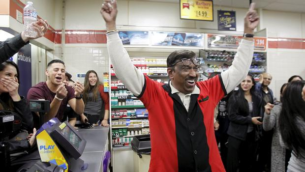 7-Eleven store clerk M. Faroqui celebrates after learning winning Powerball ticket was sold in store where he works in Chino Hills, California, on January 13, 2016