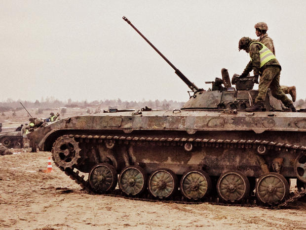 """Ukrainian soldiers prepare for """"live fire"""" exercises at a training center near Ukraine's border with Poland"""