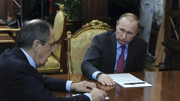 Russian President Vladimir Putin meets Foreign Minister Sergei Lavrov at the Kremlin in Moscow