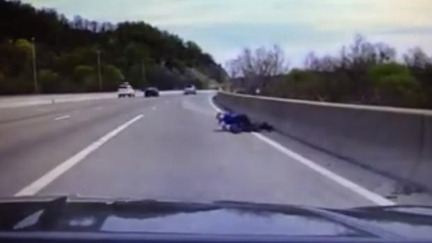 WATCH: Cop tackles man, prevents him from jumping off bridge