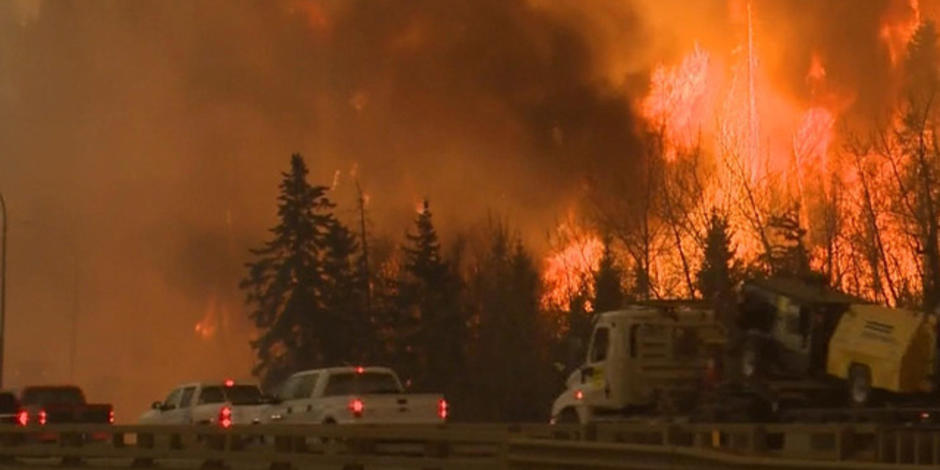 Residents scramble to flee huge Canadian fire