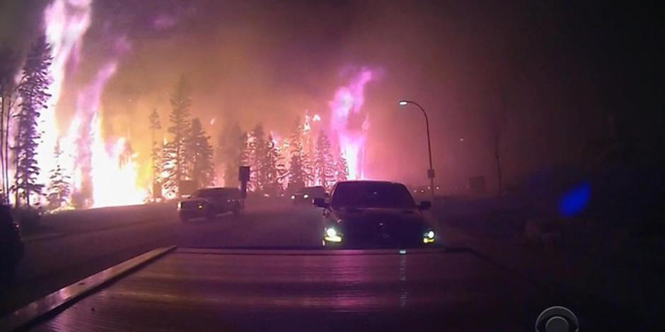 Wildfire drives massive evacuation in Alberta, Canada
