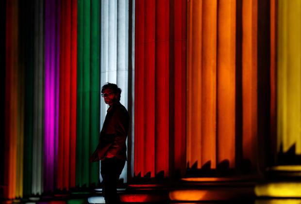 World landmarks lit in pride colors