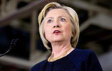 Trump defends Muslim ban, Clinton focuses on gun laws