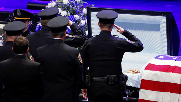Police officers pay their respects ahead of the funeral for Officer Lorne Ahrens in Plano, Texas, on July 13, 2016. Five officers, including Ahrens, were killed in a shooting incident in Dallas on July 7, 2016.