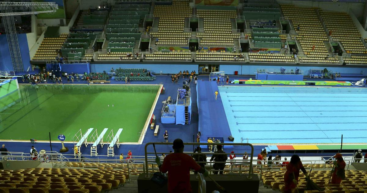 Why Did The Olympics Diving Pool Turn Green Cbs News