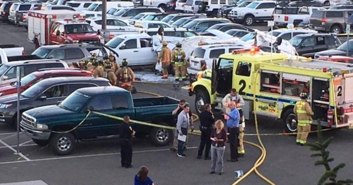 Small plane crashes onto cars at Reno airport - CBS News