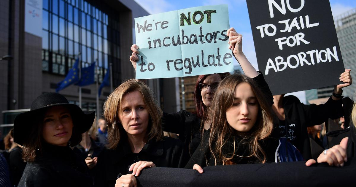 """conservative government said Wednesday that mass protests by women against  a total abortion ban have been a lesson in """"humility"""" for the country's"""