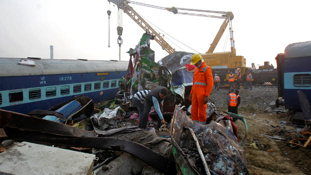 Rescuers look under Indian train wreck for bodies; 145 dead