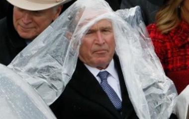 George W. Bush struggles with his poncho at Trump's inauguration
