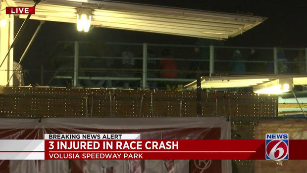 Race vehicle crashes through fence into crowd injuring three people