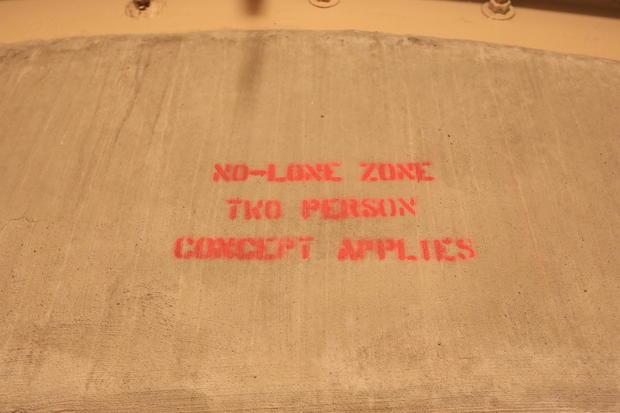 8-photo-credit-jake-barlow-no-lone-zone-stencil-over-door.jpg
