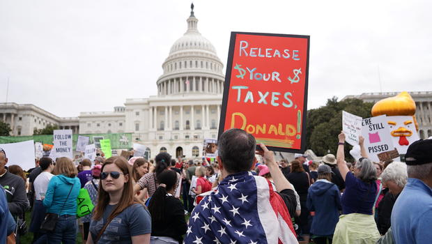 Trump plays down nationwide protests demanding release of his tax returns