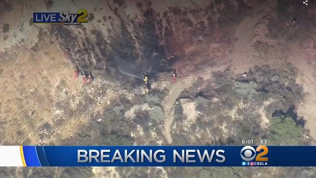 Freeway car crash sparks fire near Los Angeles – CBS News