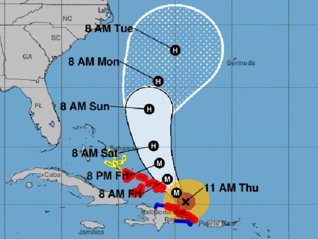 """地图显示了截至2017年9月21日上午11点的飓风玛丽亚的可能路径.M代表""""主要飓风""""。红色区域代表飓风警告。蓝色区域代表热带风暴警报。黄色区域代表热带风暴手表。"""