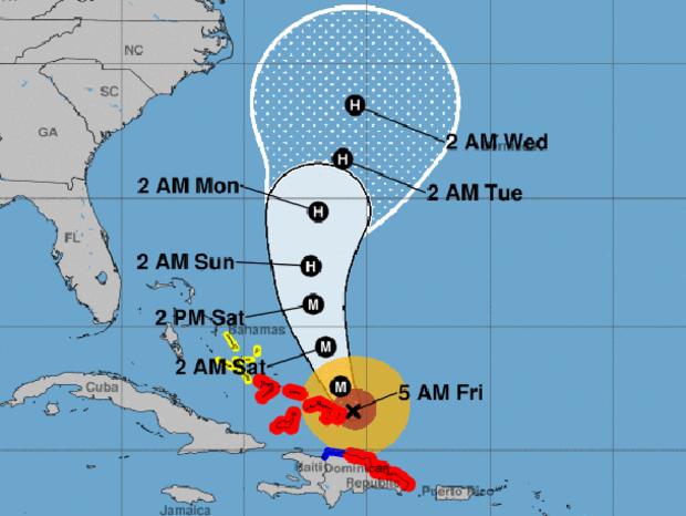 """地图显示了截至2017年9月22日上午5点的飓风玛丽亚的可能路径.M代表""""主要飓风""""。红色区域代表飓风警告。蓝色区域代表热带风暴警报。黄色区域代表热带风暴手表。"""