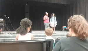 """""""I'll rise unafraid"""": Mom leaps into action when daughter freezes on stage"""